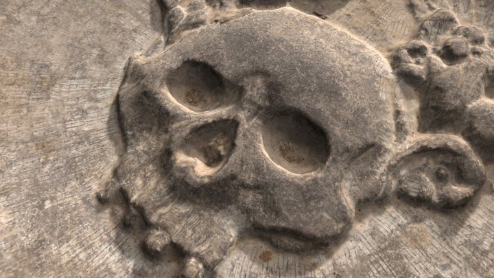 A skull carved in a gravestone dated 1700 3D Model